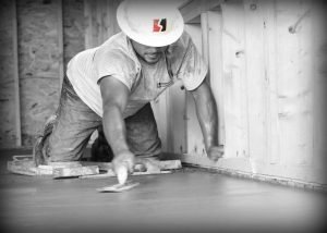 Advanced Concrete Flatwork Finisher completing a commercial project